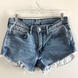 Levi's Upcycled cutoffs strings pockets show 6